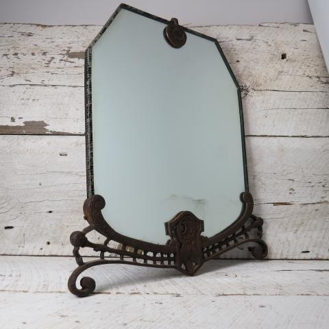 ANTIQUE - HARD TO FIND  Simple Yet Elegant Old Wall Hanging Mirror The Mirror Is Protected With A Glass Layer  And Framed With A Strong & Heavy Engraved Cast Iron Decorative Contour  The Frame Show Some Scratchs And Rust Wich Only Add Prestige To The Piece  The Mirror Look Intact But There's Some Dust Between The Glass Layer And The Mirror
